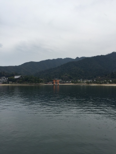 Looking at the Great Torii with Itsukushima Shrine in the background
